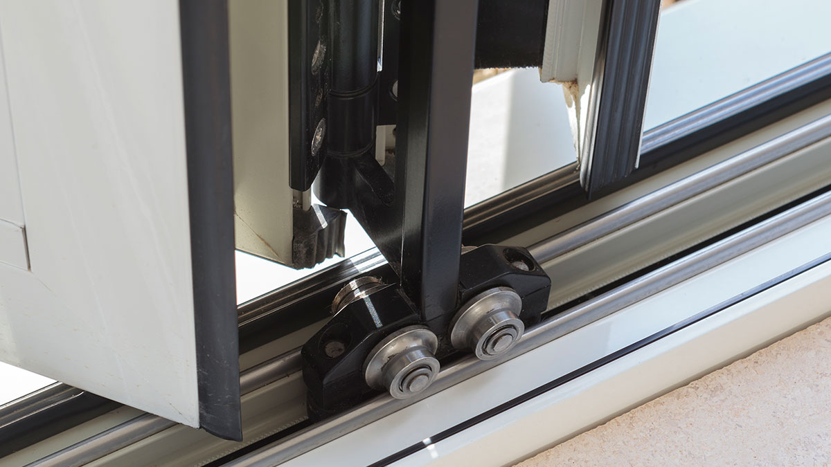 bottom roller for folding door