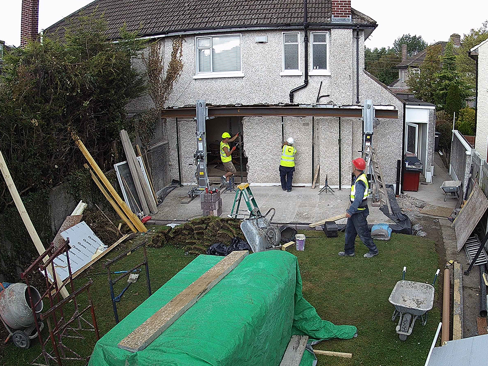 Guardian Home Extension - beam being installed